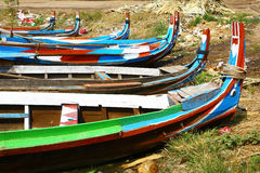 Multi colored boats on Irrawaddy river, Myanmar. Some boats on the bank of Irrawaddy, main river of Myanmar. No people Stock Image