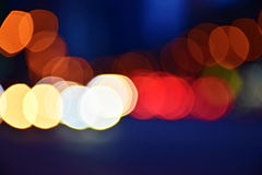 Multi Colored Bokeh on a blue background. Multi-colored Boken in white, red, orange, yellow on a blue background royalty free stock image
