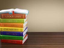 Multi colored book stack. Computer generated image of multi colored book stack on wooden table. Education concept Stock Photography