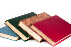 Multi-colored books lie chaotically in isolated on white background royalty free stock images