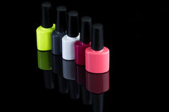 Multi-colored bottles of nail polish Stock Photography