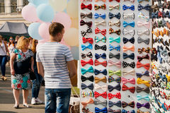 Multi-colored bow ties for suits and extravagant clothes are sold at street fair Royalty Free Stock Photography