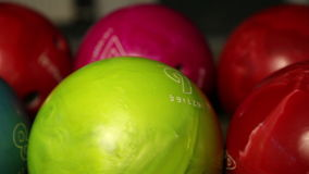 Multi-colored bowling balls, stock video footage