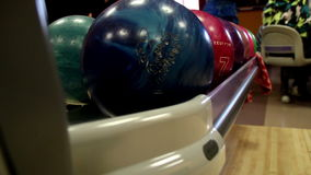 Multi-colored bowling balls rolling Royalty Free Stock Images