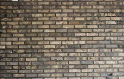 Multi-colored brick wall close-up, texture, uneven surface, background royalty free stock photography