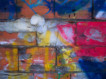 Multi colored brick wall. Multicolored by young people,this wall from a unfinished house in Portugal Royalty Free Stock Photo