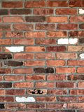 Brick Wall of Mixed Colors and Retro Looking. Multi-colored brick wall of red, white,brown and dark worn brick shot straight on Stock Photography