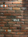 Brick Wall of Mixed Colors and Retro Looking. Multi-colored brick wall of red, white,brown and dark worn brick shot straight on Royalty Free Stock Photos