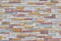 Multi-colored brick wall.Wall of slate. Multi-color old and grun Stock Photos