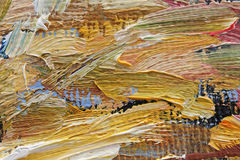 Multi-colored brush strokes of oil paint on canvas Stock Image
