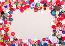 Multi colored buttons on fabric Royalty Free Stock Photos