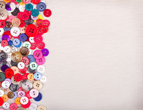 Multi colored buttons on fabric Stock Image