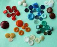 Multi colored buttons. Are laid out on the table Royalty Free Stock Photo