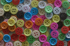 A Multi colored buttons on light wood table Royalty Free Stock Photography