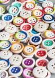 Multi colored buttons wooden background Stock Photos