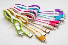 Multi-colored cables. For charging on isolated background Stock Photo