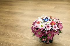 Multi-colored camomiles and other spring flowers in a bouquet stock images