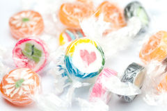 Multi-colored candies in shiny wrappers Stock Photos