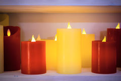 Multi-colored candles are arranged in a single row. Stock Image