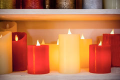 Multi-colored candles are arranged in a single row. Royalty Free Stock Photography