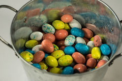 Multi-colored candy Easter Eggs in a metal bucket Stock Photography