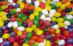 Multi colored candy in the form of peas Royalty Free Stock Image