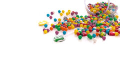 Multi colored candy. Spilled onto table stock photo