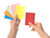 Multi-colored cards in hands Royalty Free Stock Images