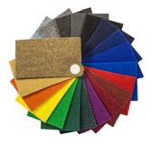 Multi-colored carpeting samples by a fan. Multi-colored carpeting samples in the form of a fan isolated on white background royalty free stock images