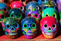 Multi-colored ceramic decorative skull. Traditional Mexican souvenirs. The symbol of the holiday of the day of the dead. Multi-colored ceramic decorative skull royalty free stock image