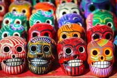 Multi-colored ceramic decorative skull. Traditional Mexican souvenirs. The symbol of the holiday of the day of the dead. Multi-colored ceramic decorative skull royalty free stock photography