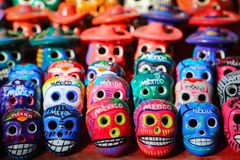 Multi-colored ceramic decorative skull. Traditional Mexican souvenirs. The symbol of the holiday of the day of the dead.  stock photos