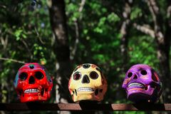 Multi-colored ceramic decorative skull. Traditional Mexican souvenirs. The symbol of the holiday of the day of the dead.  stock photo