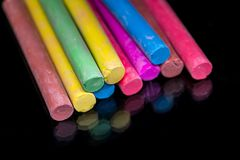 Multi colored chalk isolated on black. Background Stock Photo