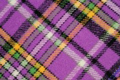 Multi-colored checkered fabric. Colourful checkered fabric for sewing, as background Royalty Free Stock Image
