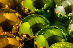 Multi-colored Christmas balls - red, orange, blue, purple and green as a background.  Royalty Free Stock Images
