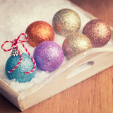 Multi colored christmas balls with red and white ribbon decorati Royalty Free Stock Photos