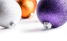 Multi colored christmas balls on white background. Royalty Free Stock Image