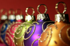 Multi colored Christmas baubles stock image