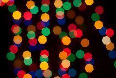 Multi-colored Christmas lights bokeh is Stock Images