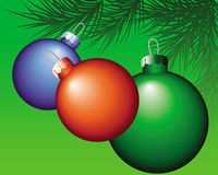 Multi-colored Christmas tree toys. New colorful Christmas decorations on a green background Stock Photo
