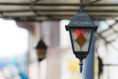 Multi colored classic hanging street lamp. outside Stock Photo