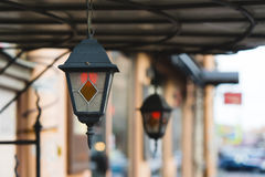 Multi colored classic hanging street lamp. outside Stock Photos