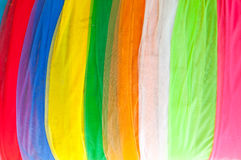 Multi-colored cloth used for decoration in thailand temple. Colorful fabric texture samples Stock Photo