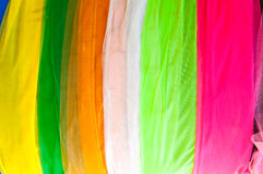 Multi-colored cloth used for decoration in thailand temple. Colorful fabric texture samples Stock Image
