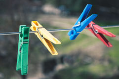 Multi-colored clothespins Stock Images