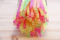 Multi-colored cocktail stick. Selective focus Stock Photo