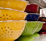 Multi Colored Colanders Royalty Free Stock Photography