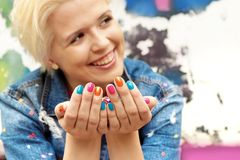 Multi-colored confetti and colorful manicure Royalty Free Stock Photography