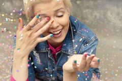 Multi-colored confetti and colorful manicure Royalty Free Stock Photo